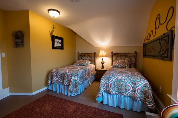 The Buckaroo Room features twin beds and a walk-in closet